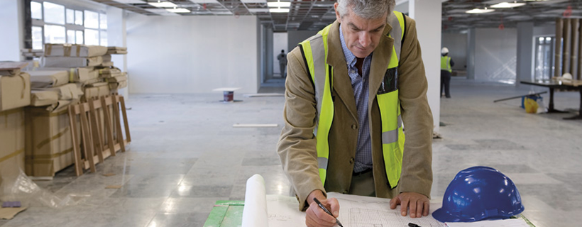 Facilities manager reviewing plans in new building